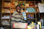 Emmanuel inside his small retail shop.
