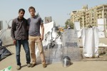 Adams and I next to confiscated riot gear and symbolic graves memorializing the Jan 25 revolution martyrs.